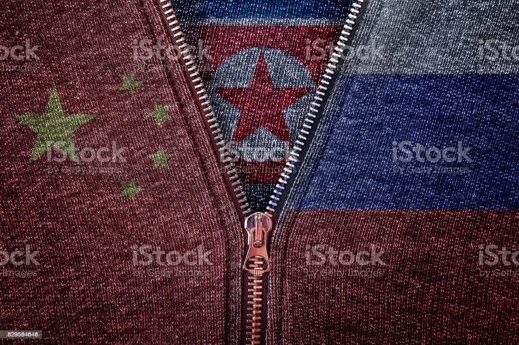 north korea, china and russia flag on clothes, international relations of north korea, china and russia, concept is that china and russia support north korea stock photo