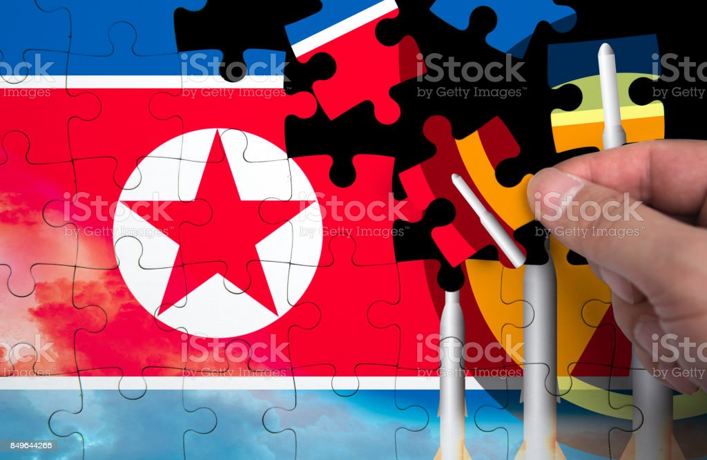 North Korea Missile weapons. Flag of North Korea. puzzle pieces stock photo