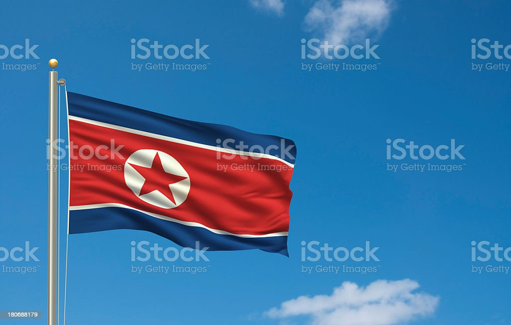 North Korean flag raised and waving in the blue sky stock photo