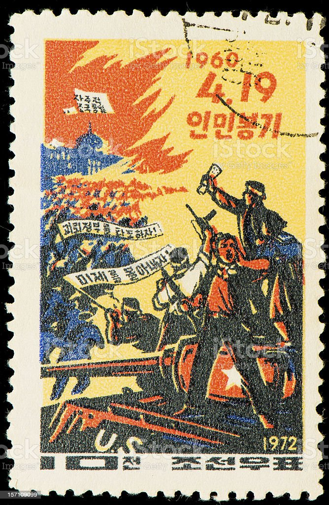 North Korean postage stamp from 1972 with people rioting stock photo