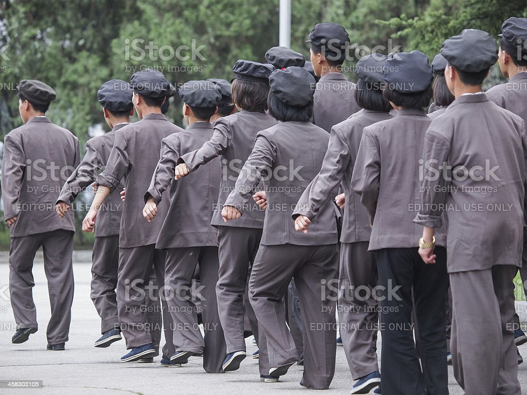 North Korean teenagers marching to the coal factories stock photo