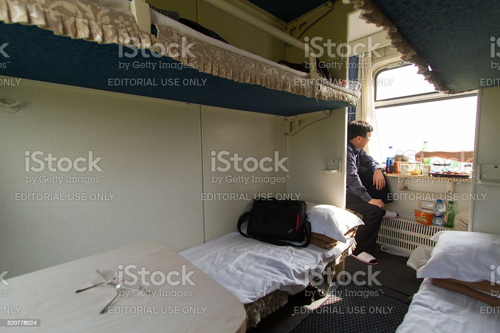 North Koreans enjoy noodles & Pepsi on China-Pyongyang train stock photo