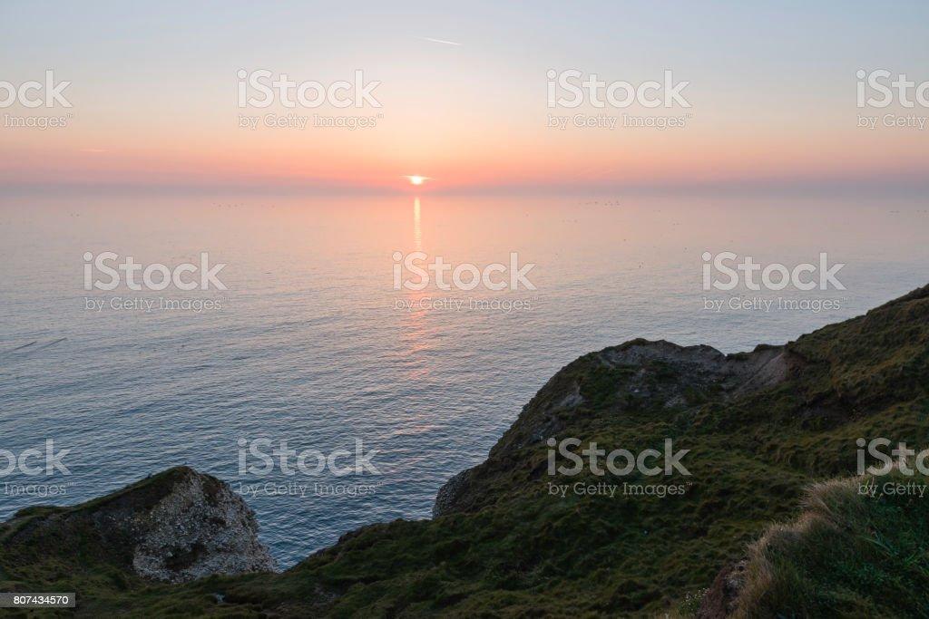 North Sea at dawn and coastline at Flamborough, Yorkshire, UK. stock photo