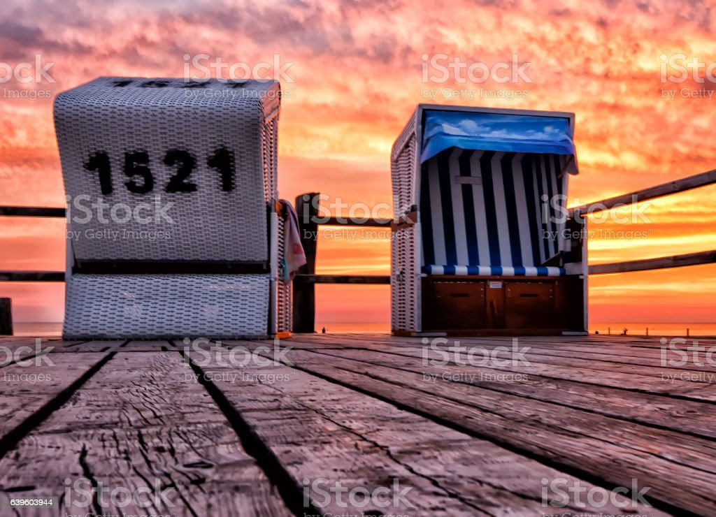 North Sea Beach Chair in St Peter Ording during Sunset stock photo