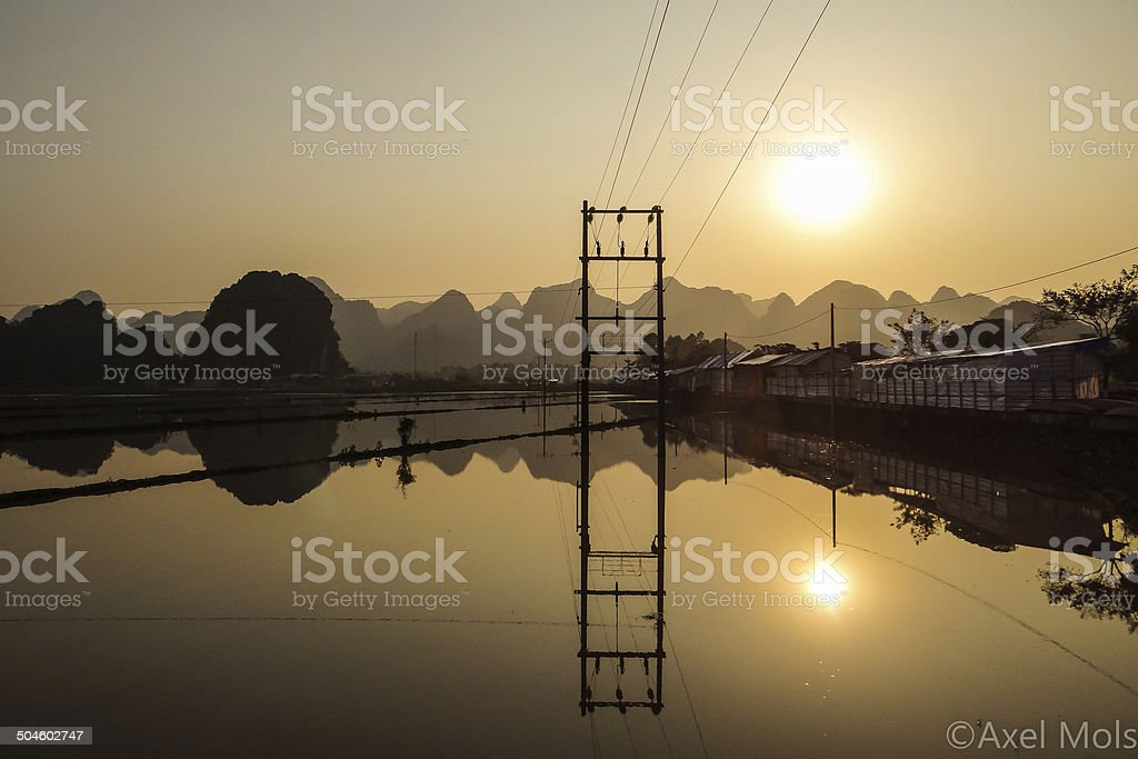 North Vietnamese Sunset Reflection stock photo