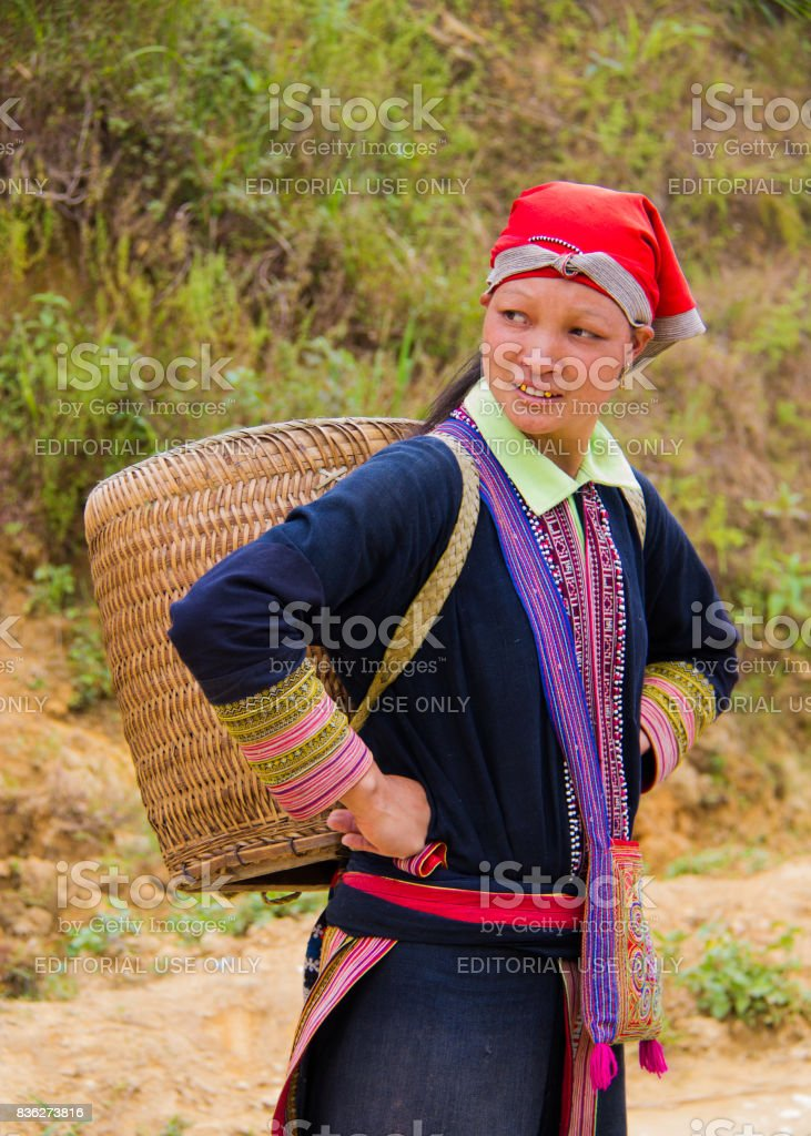 North Vietnamese woman carries empty basket on her back stock photo