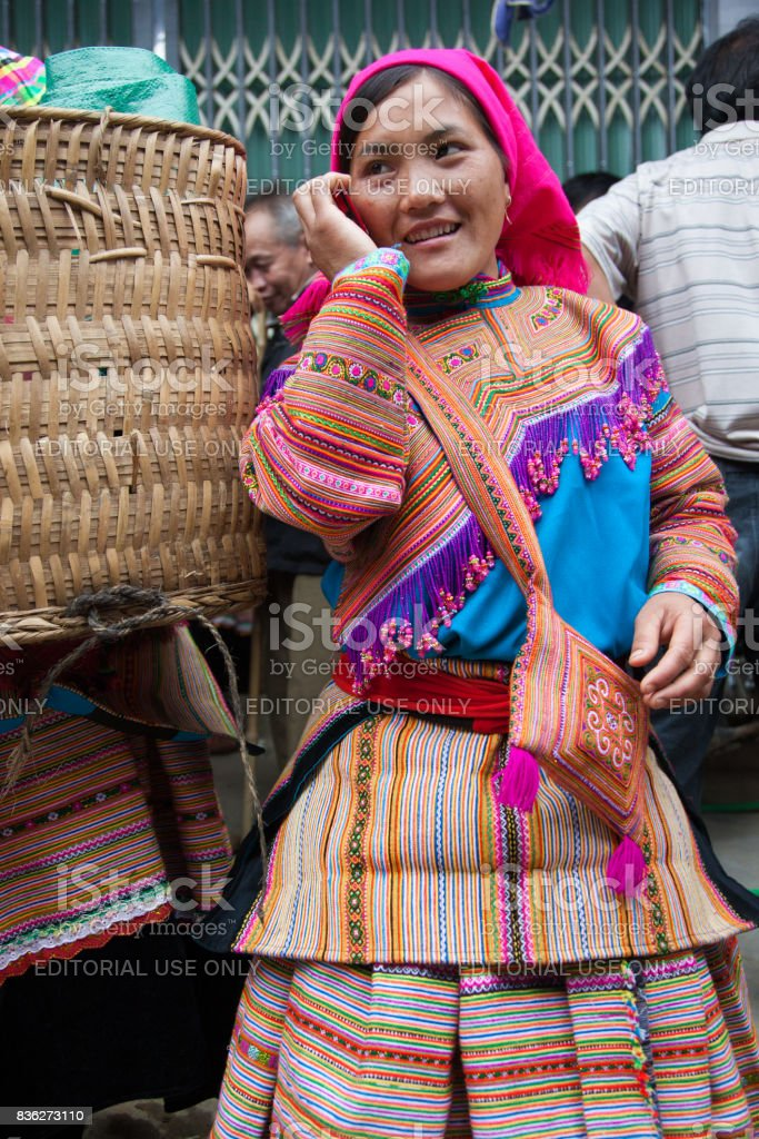 North Vietnamese woman in colorful native clothing at Bac Ha market stock photo