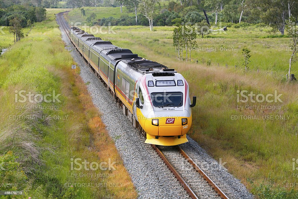 Northbound Cairns Tilt Train in remote tropical country stock photo