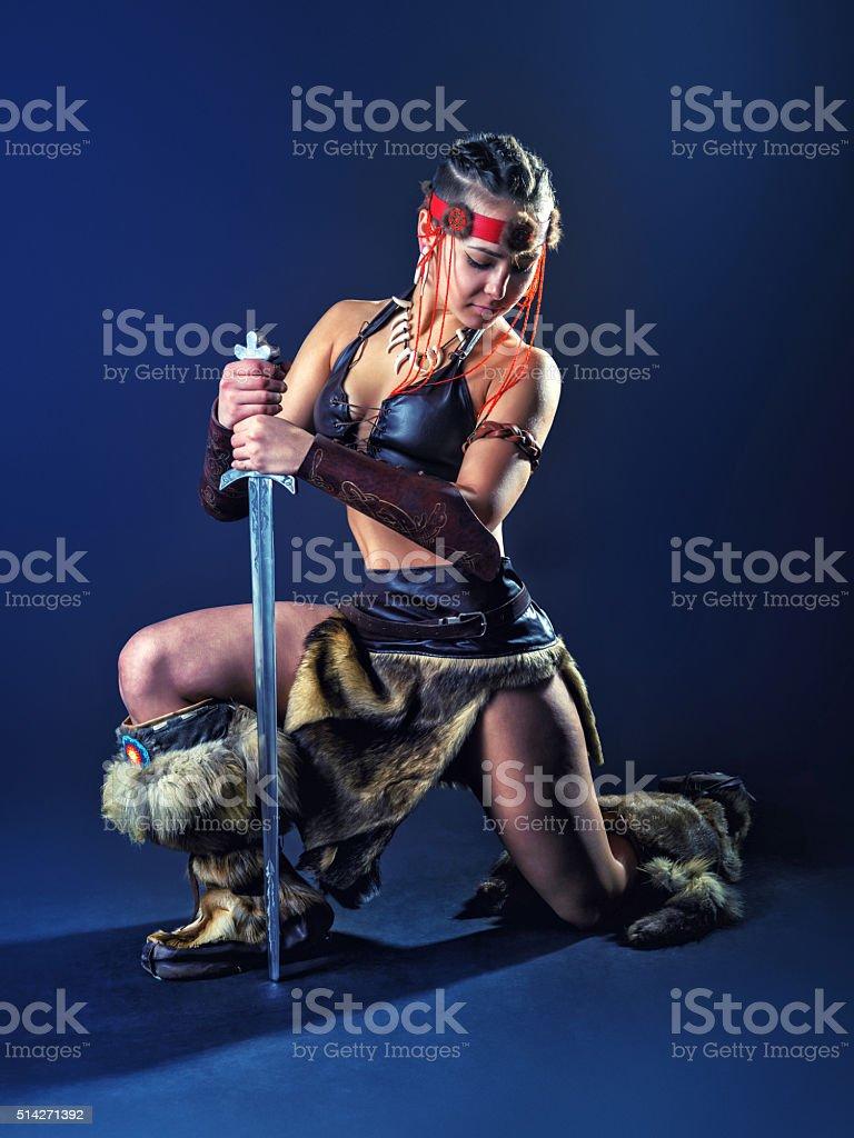 Northern girl warrior on one knee stock photo