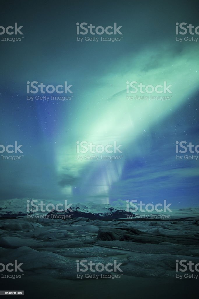 Northern lights (Aurora borealis) above a lagoon in Iceland royalty-free stock photo
