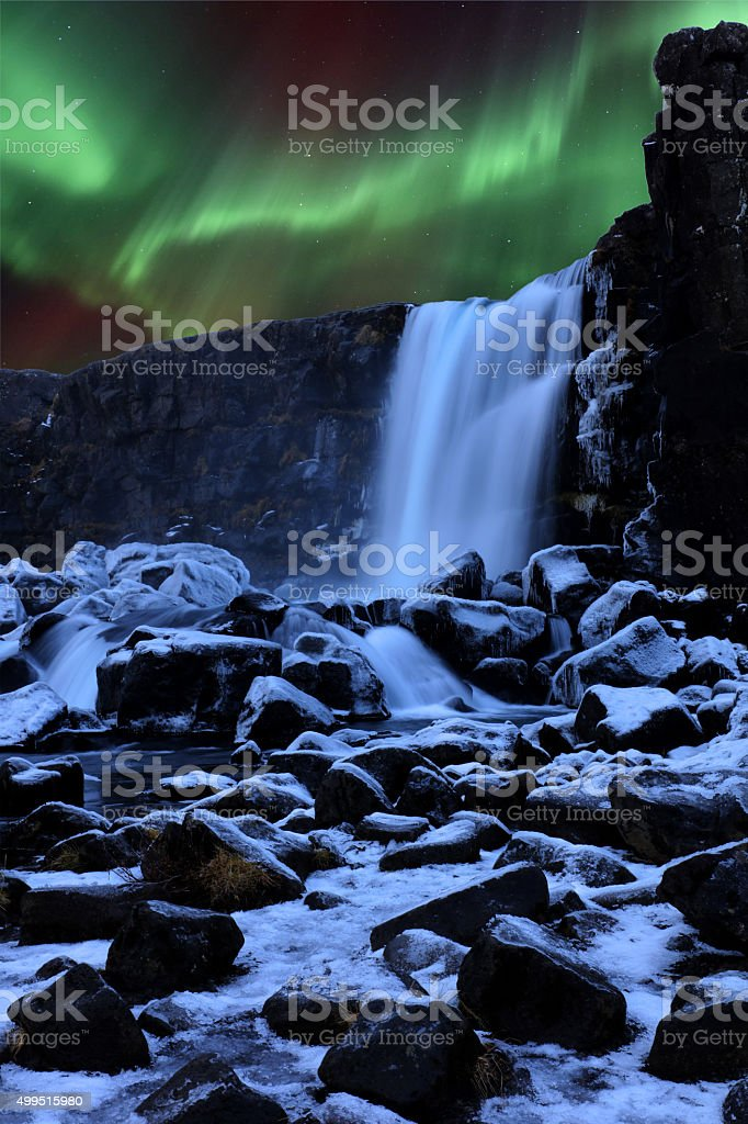 Northern Lights above Oxararfoss Waterfall in Iceland stock photo