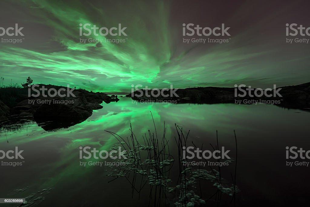 Northern lights above the Ladoga lake stock photo