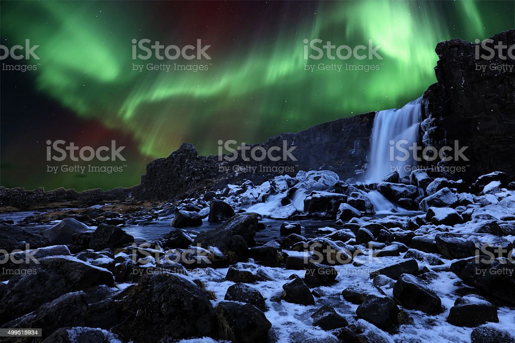 Northern Lights and Oxararfoss Waterfall in Thingvellir Iceland stock photo