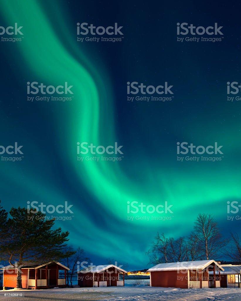 Northern lights - Aurora borealis over Rorbuer, Norway stock photo