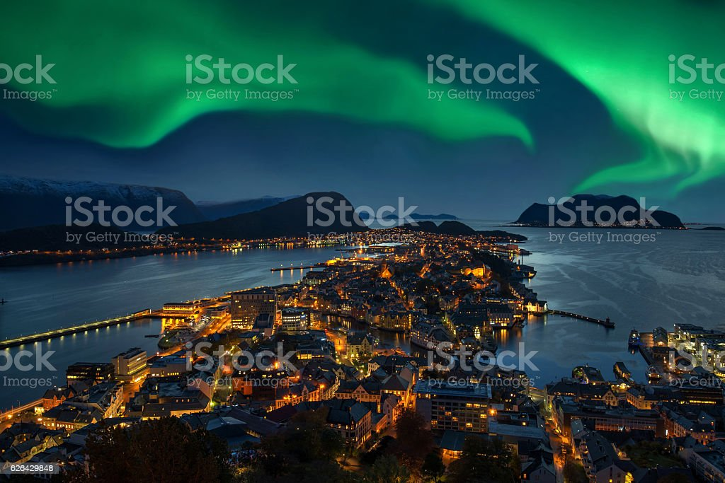 Northern lights - Green Aurora borealis over Alesund, Norway stock photo