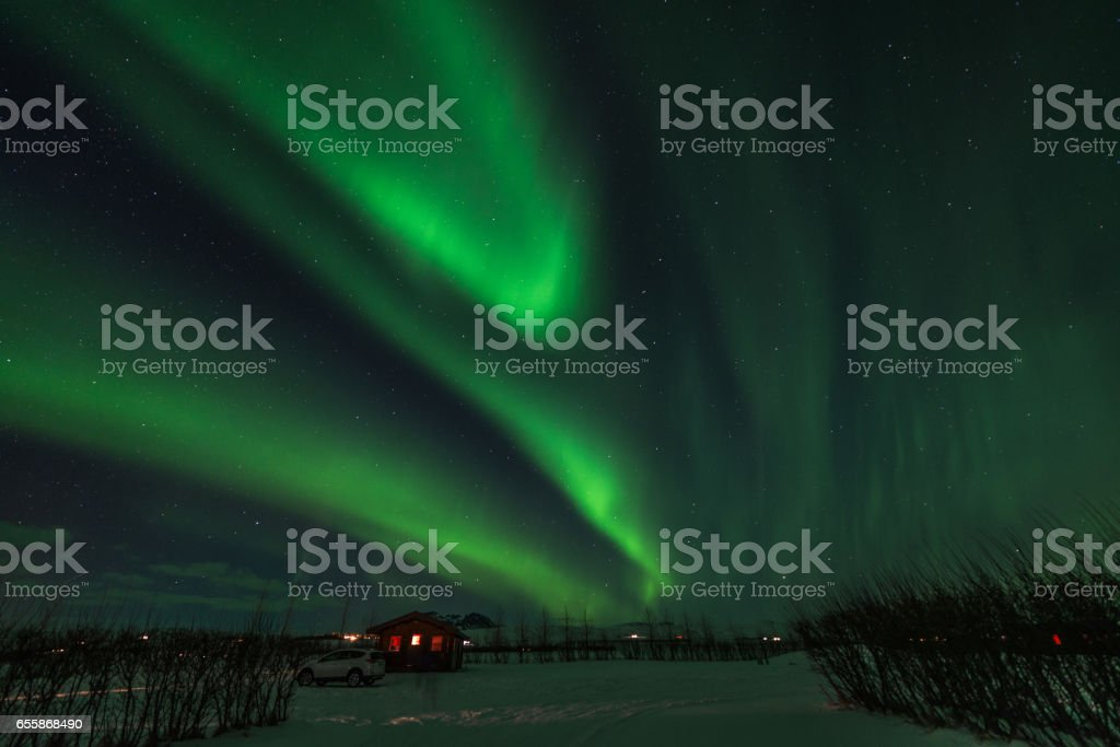 Northern lights in a cold night in Iceland, Snow stock photo