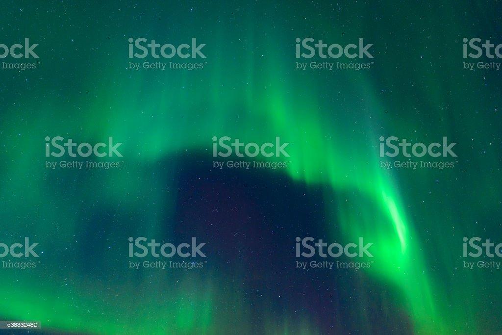 Northern Lights in night sky over Lofoten Islands in Norway stock photo