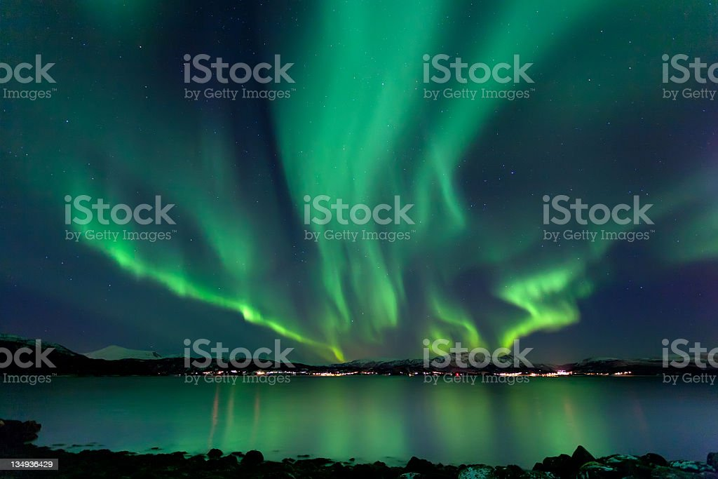 Northern Lights of the Aurora Borealis reflect on water stock photo