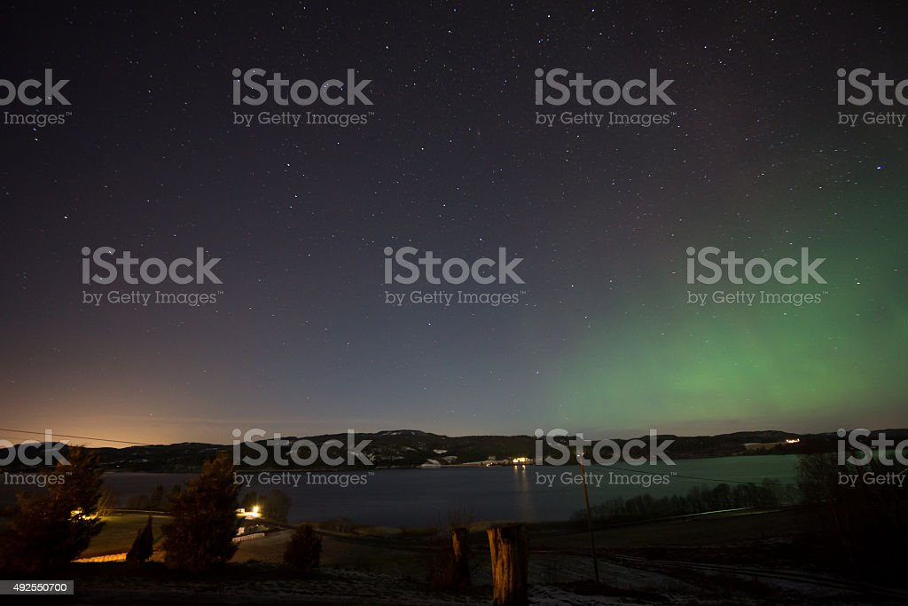 Northern lights over a lake royalty-free stock photo