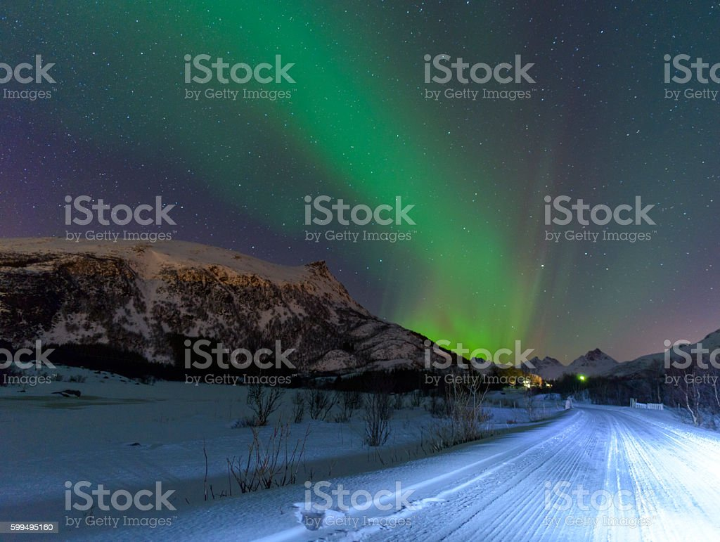 Northern Lights over a road in  Norway stock photo