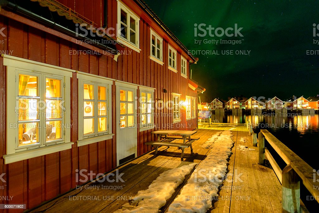 Northern lights over cabins Svolvaer harbor Lofoten, Norway stock photo