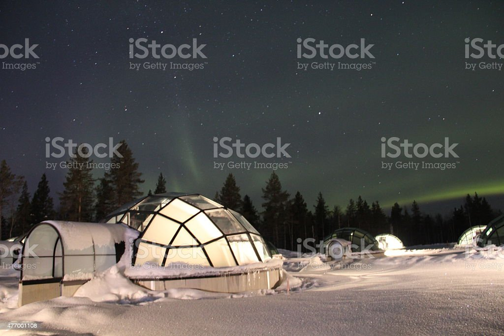 Northern Lights over Glass Igloos in Finland stock photo