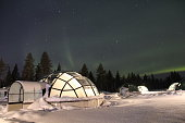 Northern Lights over Glass Igloos in Finland