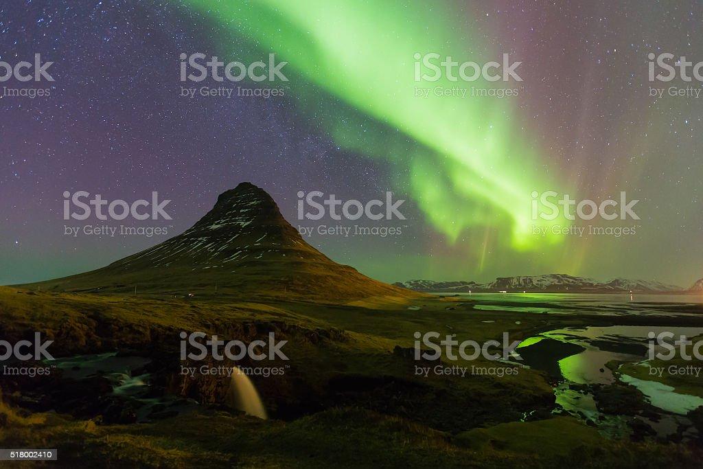 Northern lights over Kirkjufell volcano stock photo