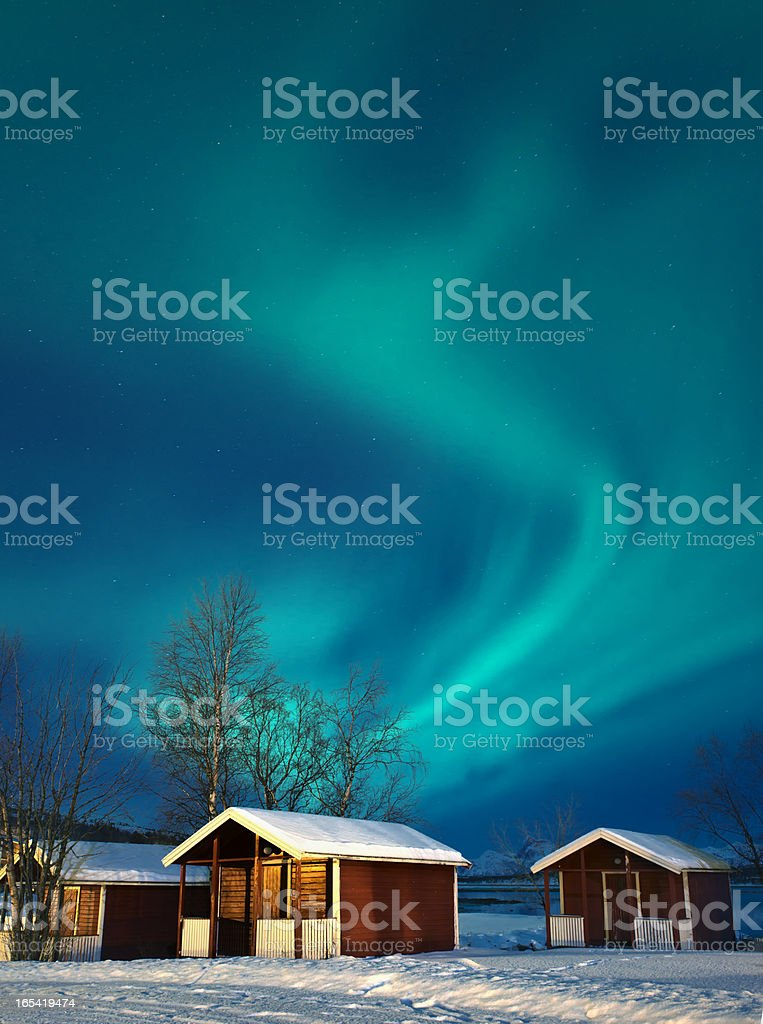 Northern lights (Aurora borealis) over Norwegian rorbuer in winter (XXXL) royalty-free stock photo
