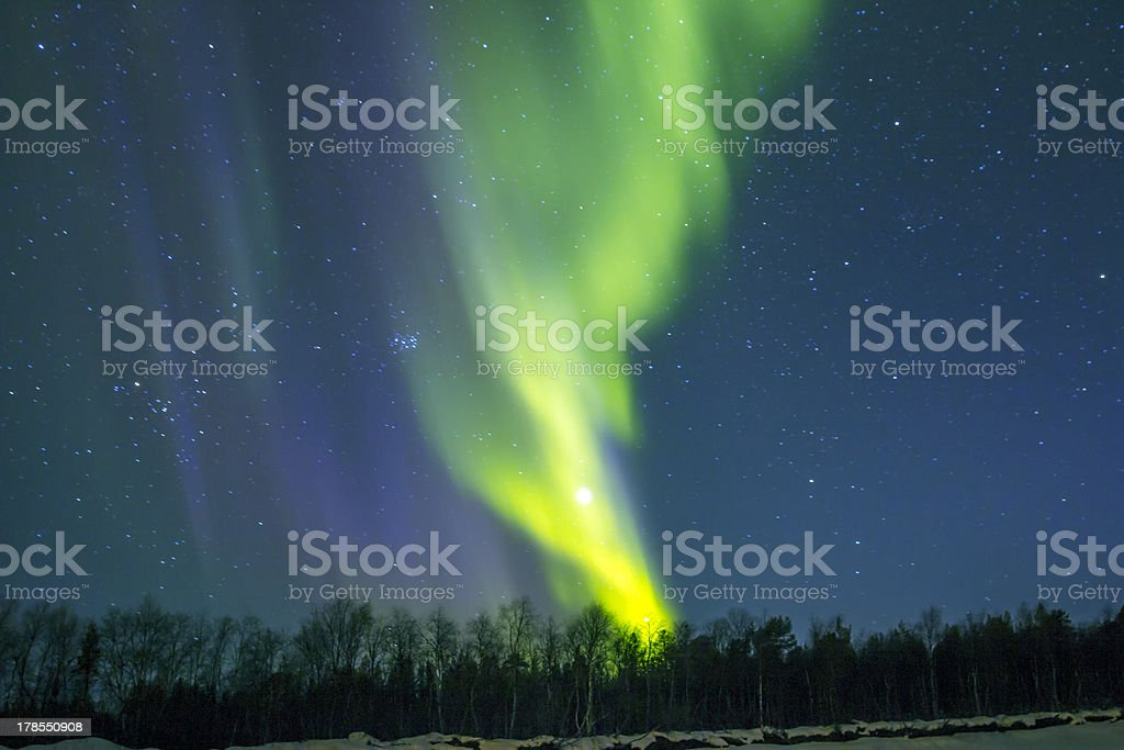 Northern Lights (Aurora borealis) over snowscape. stock photo