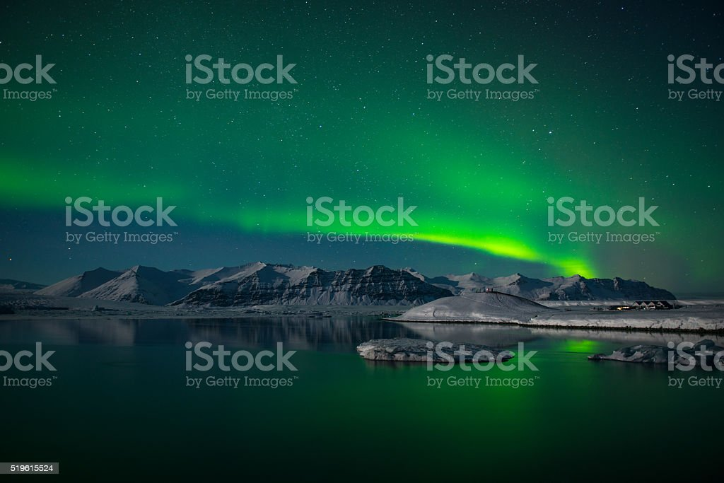 Northern lights over the glacier lagoon Jokulsarlon, Iceland stock photo