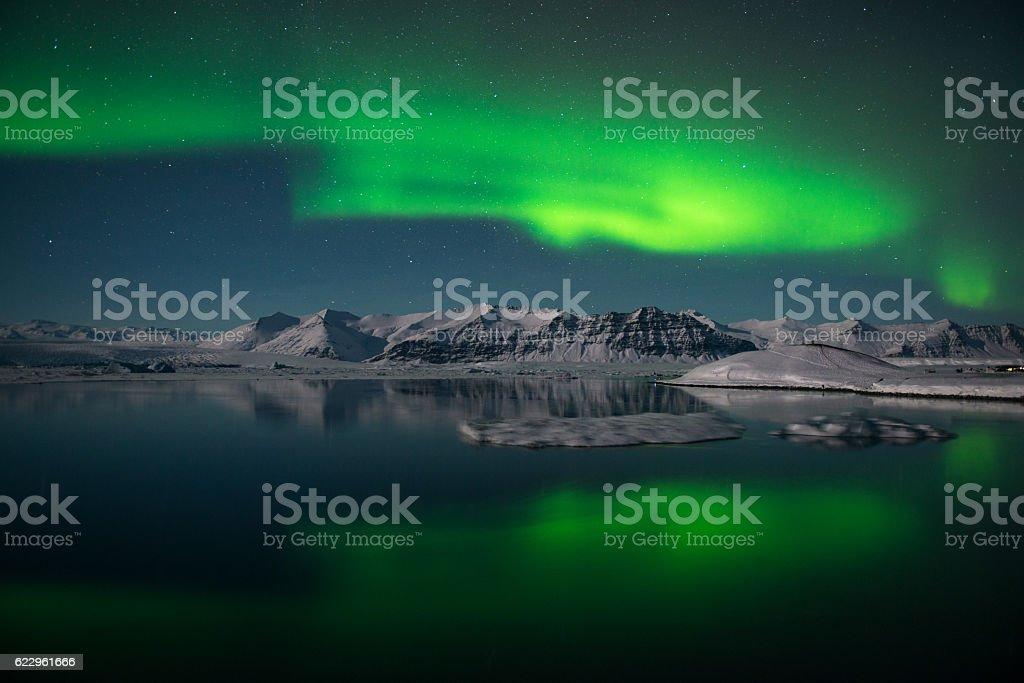 Northern lights over the glacier lagoon Jokulsarlon, Iceland stock photo
