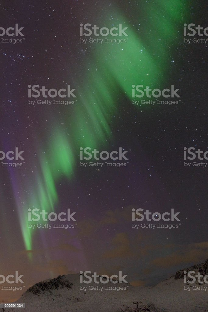 Northern Lights over the mountains at the Lofoten Islands Norway stock photo