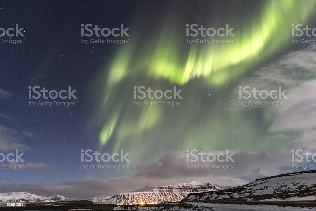 Northern Lights over town in Iceland royalty-free stock photo