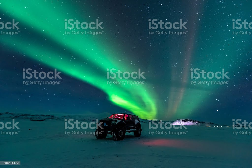 Northern lights over truck stock photo