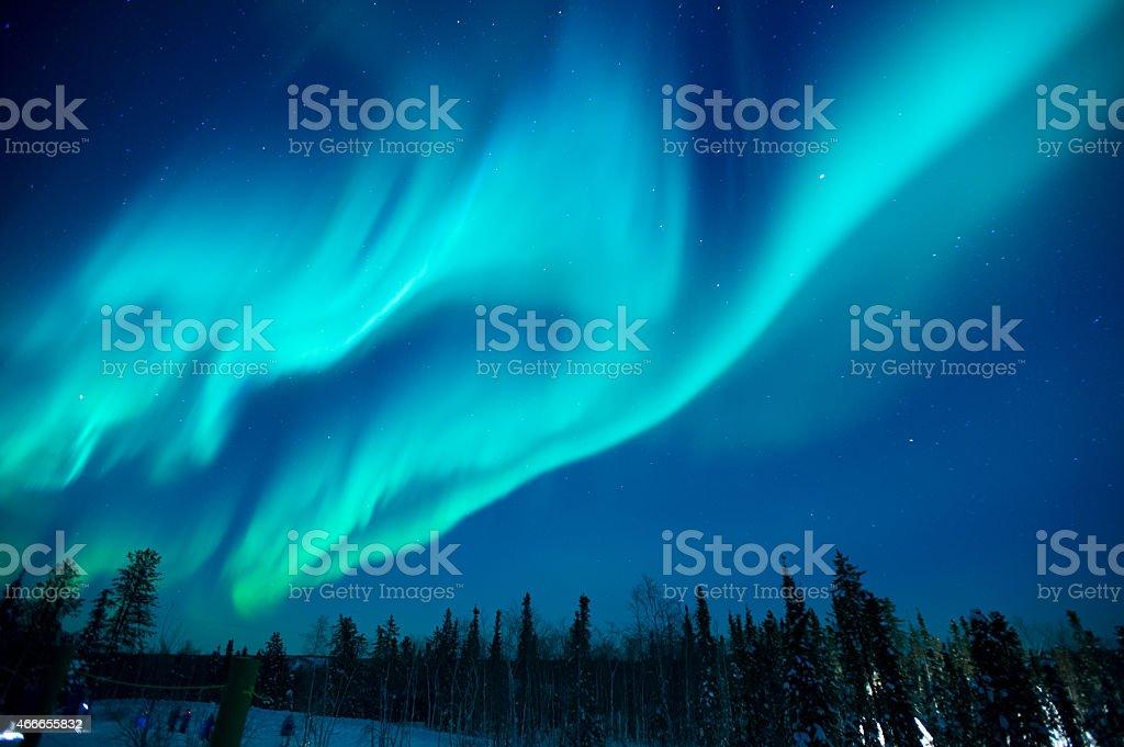 Northern lights stream across the arctic sky near Yellowknife stock photo