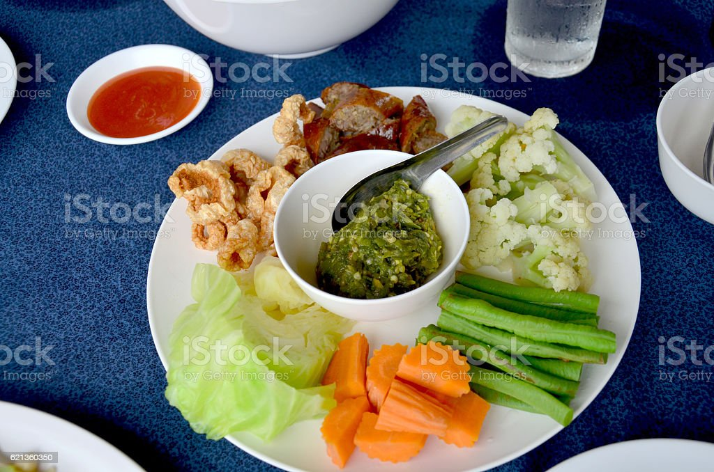 Northern Thai sausage and Green chilli dip with boiled vegetable stock photo