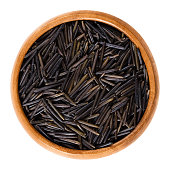 Northern wild rice in wooden bowl
