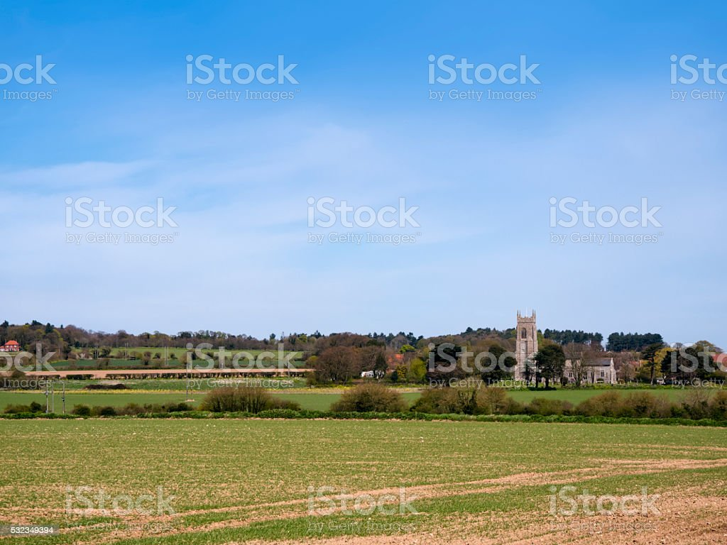 Northrepps church with Norfolk fields stock photo