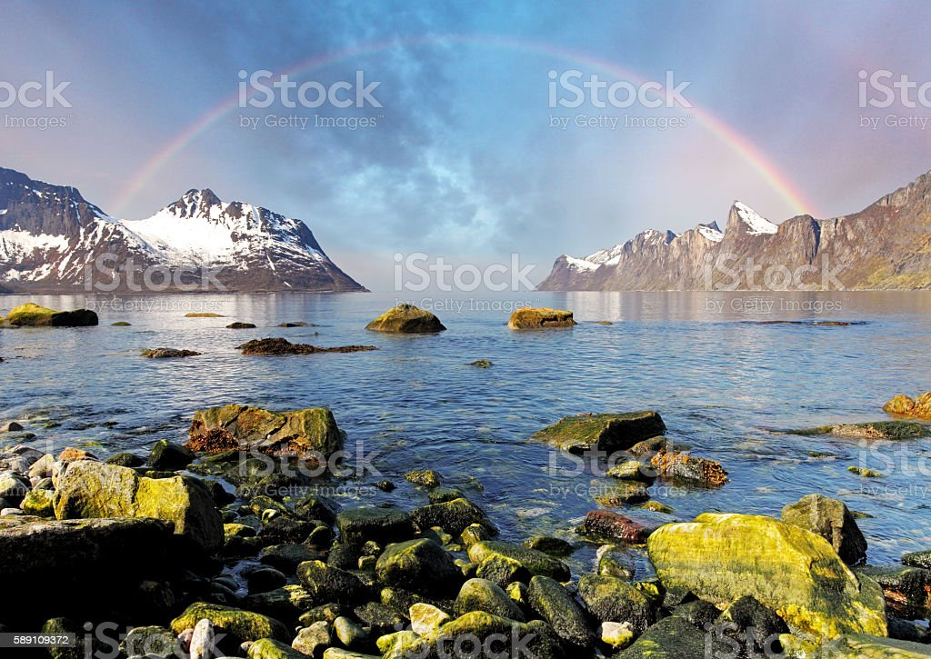 Norway fjord with rainbow over sea stock photo