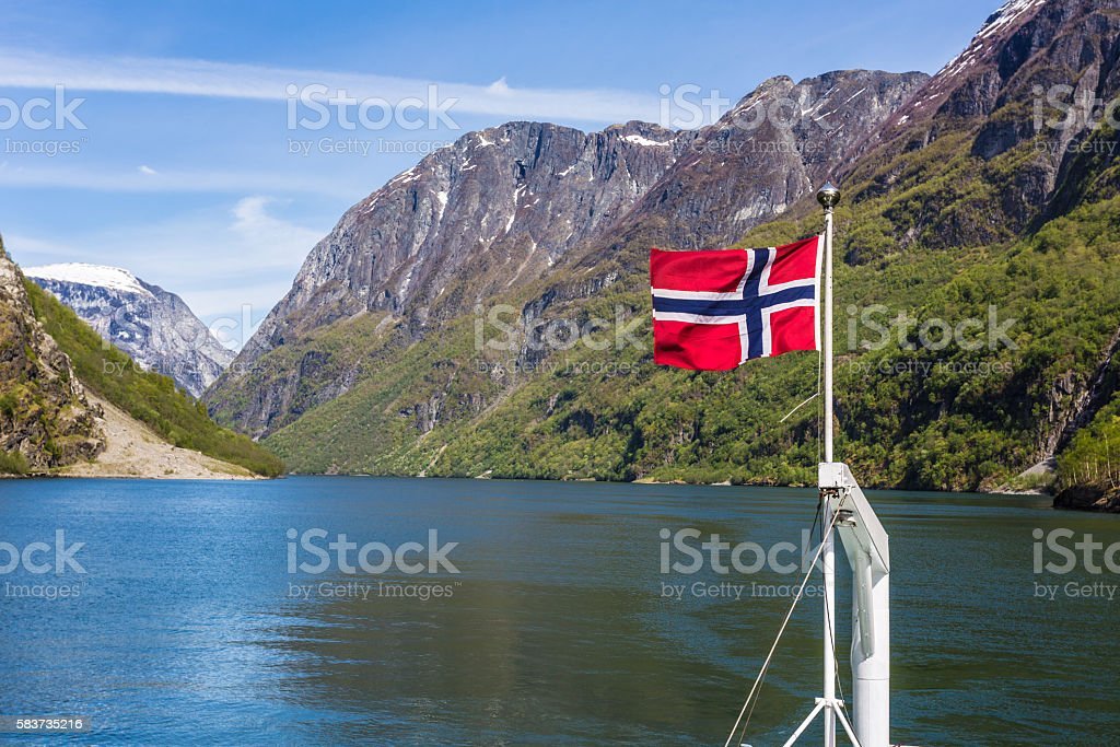 Norway flag in a fjord stock photo