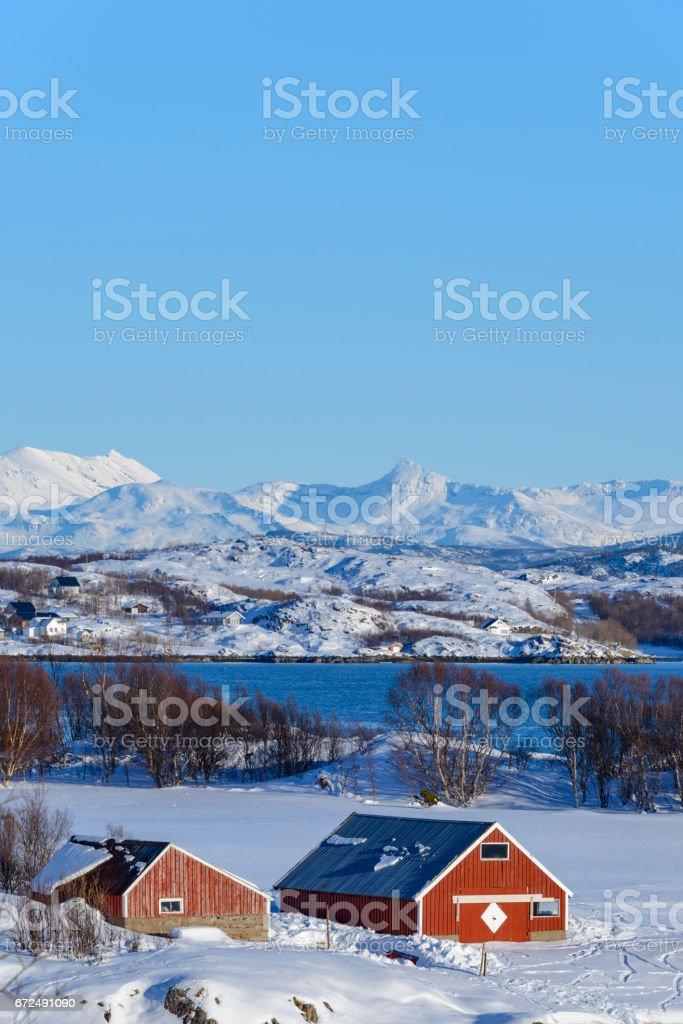 Norwegian farm in a snowy winter landscape stock photo