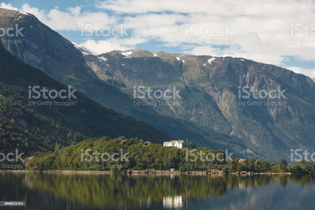 Norwegian fjord landscape with mountains and houses. Sorfjorden. Norway. stock photo