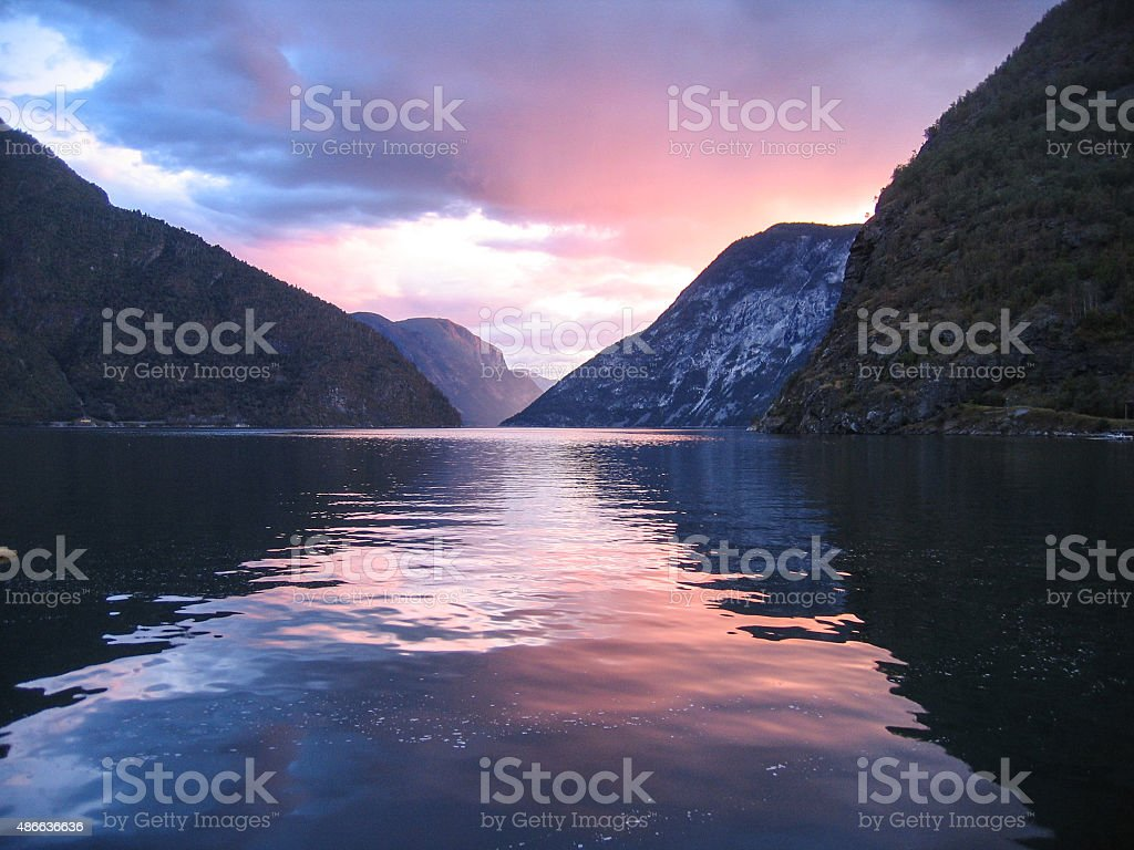 Norwegian fjords with clouds reflection in water stock photo