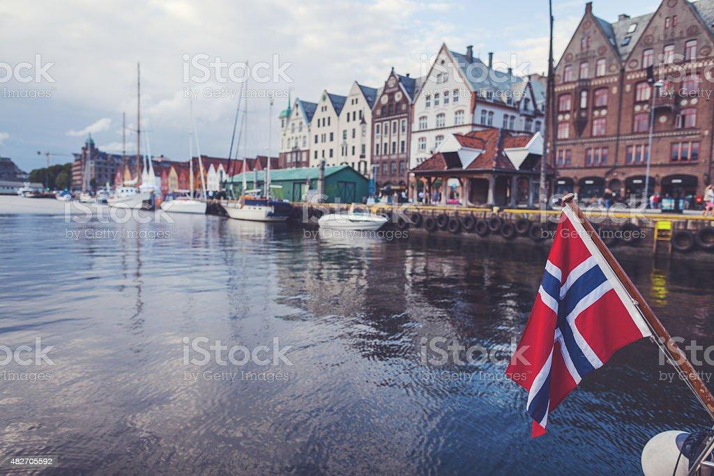 Norwegian flag and Bryggen old town in Bergen stock photo