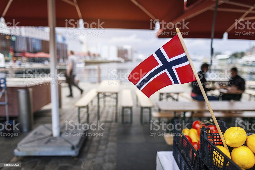 Norwegian flag at the harbor in Bergen stock photo