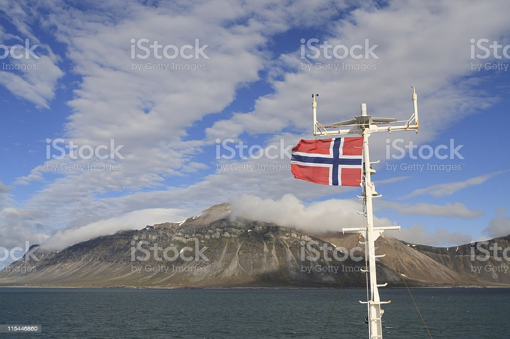 Norwegian Flag In Arctic Landscape royalty-free stock photo