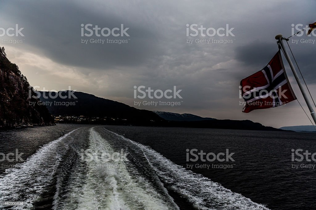 Norwegian flag on Fanaraaken ferry from Flam to Gudvangen stock photo