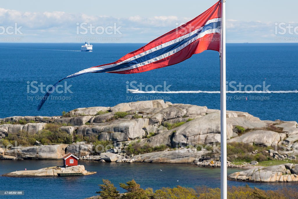 Norwegian flag with a pretty cabin on an island stock photo
