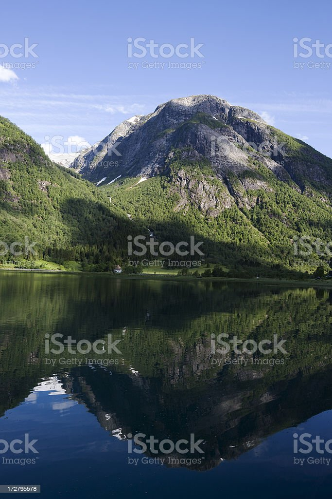 Norwegian Mountain and Tranquil Fjord stock photo